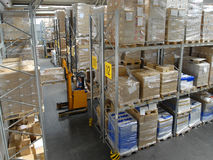 Warehouse with high shelves Stock Images