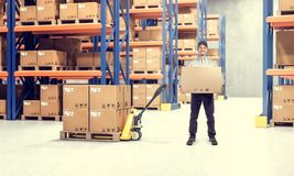 Warehouse indoor view. Man in classic warehouse with pallet 3d rendering image stock photo