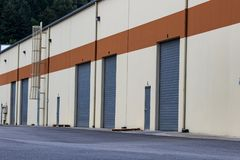 Warehouse industrial building and garage doors stock images