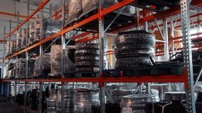 Warehouse industrial goods. Logistics distribution system. Factory warehouse. Warehouse industrial goods. Rows of shelves with packaged goods in modern stock footage