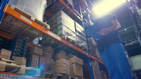 A warehouse inspector during work under sunlight rays. stock footage