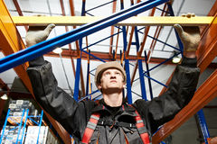 Warehouse installer worker examining quality Stock Images