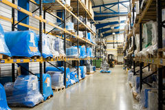 Warehouse interior. With manufacturing gods on the shelves Royalty Free Stock Photo
