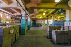 Warehouse interior. Cardboard boxes with finished production ready for transportation stock image