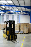 Warehouse interior and forklift Royalty Free Stock Photography