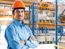 Warehouse-keeper. Portrait of a smiling warehouse-keeper at work royalty free stock images
