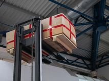 Warehouse loader forklift lifting pallet with big box package at diy store warehouse royalty free stock images