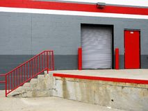 Warehouse: loading bay steps. Bright painted warehouse with loading bay doors and steps Stock Photo