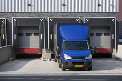 Warehouse loading dock. And a blue truck stock photos