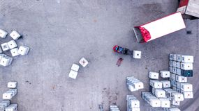 Warehouse man worker with forklift. Loading truck. Aerial Royalty Free Stock Photo