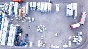 Warehouse man worker with forklift. Loading truck. Aerial stock images