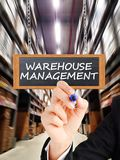Warehouse management with business woman, logistic manager royalty free stock photography