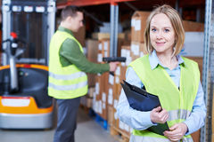 Warehouse Management System. female worker portrait. Male and female warehousing worker in storehouse with wireless barcode scanner. Warehouse Management System royalty free stock images