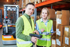 Warehouse Management System. Worker with barcode scanner Stock Image