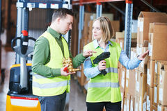 Warehouse Management System. Worker with barcode scanner. Male and female warehousing worker in storehouse with wireless barcode scanner. Warehouse Management stock images