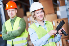 Warehouse Management System. Worker with barcode scanner Stock Photography