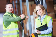 Warehouse Management System. Worker with barcode scanner Royalty Free Stock Photo