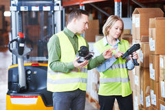 Warehouse Management System. Worker with barcode scanner Royalty Free Stock Photos