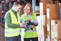 Warehouse Management System. Worker with barcode scanner. Male and female warehousing worker in storehouse with wireless barcode scanner. Warehouse Management stock photo