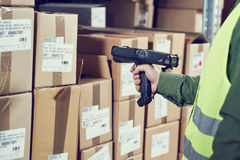 Warehouse Management System. Worker with barcode scanner. Warehouseman worker using wireless barcode scanner. Warehouse Management System Royalty Free Stock Photos
