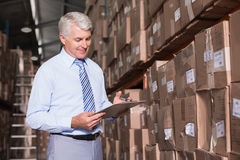 Warehouse manager checking his inventory Stock Photography
