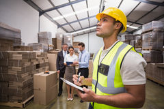 Warehouse manager checking his inventory Royalty Free Stock Images