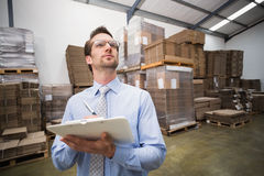 Warehouse manager checking his inventory Royalty Free Stock Photography