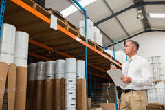 Warehouse manager checking his list on clipboard Stock Image