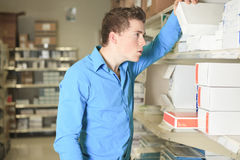 Warehouse manager checking the inventory Stock Photo