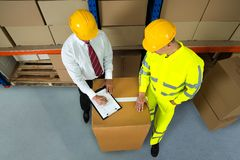 Warehouse Manager Checking Inventory In Warehouse Stock Image