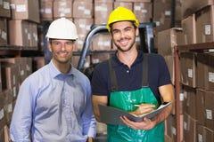 Warehouse manager and foreman smiling at camera Royalty Free Stock Photos