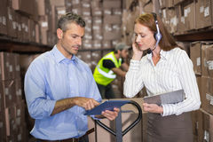 Warehouse manager and foreman working together Royalty Free Stock Photography