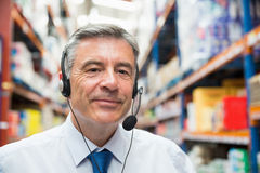 Warehouse manager giving orders on headset Stock Photo