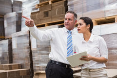 Warehouse manager and her boss checking inventory Stock Images