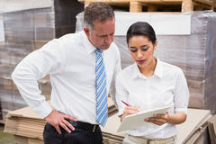 Warehouse manager and her boss working together Stock Photo