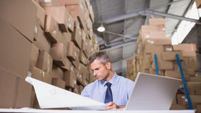 Warehouse manager looking at blueprint royalty free stock images