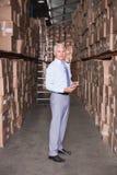 Warehouse manager smiling at camera Royalty Free Stock Photos