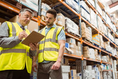 Warehouse manager speaking with foreman Royalty Free Stock Photos