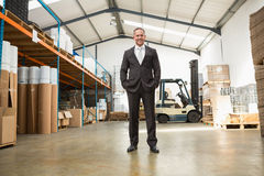 Warehouse manager standing with hands in the pocket Royalty Free Stock Image