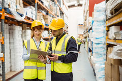 Warehouse manager talking with worker Royalty Free Stock Image