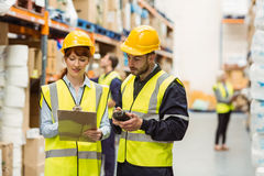 Warehouse manager talking with worker Royalty Free Stock Images