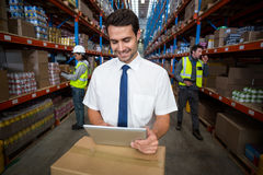 Warehouse manager using digital tablet Royalty Free Stock Image