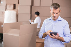 Warehouse manager using his calculator Stock Photo