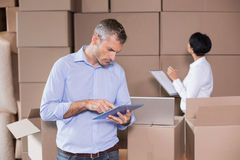 Warehouse manager using his tablet pc Stock Photos