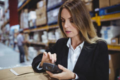 Warehouse manager using scanner Royalty Free Stock Photos