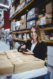 Warehouse manager using scanner Stock Image