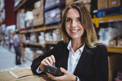 Warehouse manager using scanner Stock Photography