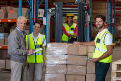 Warehouse manager and workers preparing a shipment Stock Images