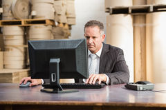 Warehouse manager working on computer Royalty Free Stock Photography