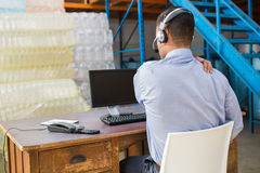 Warehouse manager working on computer Royalty Free Stock Image